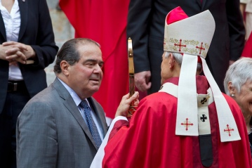Scalia talks with Archbishop of Washington Wuerl at conclusion of annual Red Mass held at Cathedral of St. Matthew Apostle in Washington